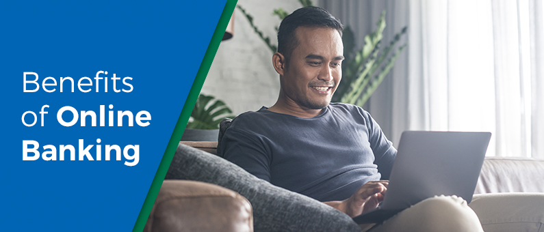 Benefits of Online Banking - man seated on the couch looking at a laptop